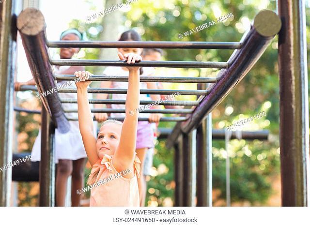 Schoolgirl hanging on monkey rack