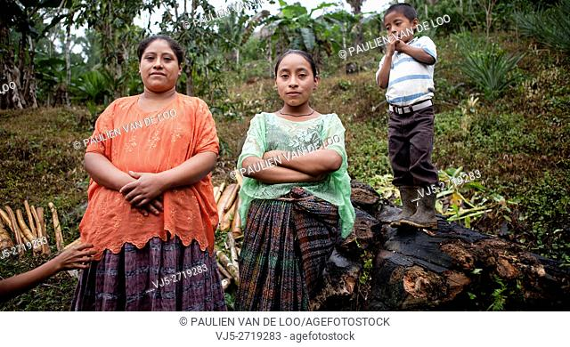 Chahal, Alta Verapaz, Guatemala, young maya tribe girls and a boy are watching me