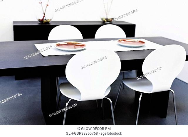Chairs with a table in a dining room