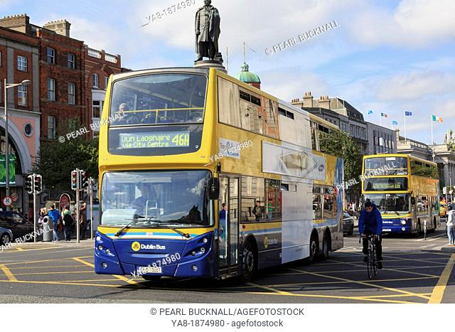 O'Connell Street, Dublin, County Dublin, Republic of Ireland, Eire, Europe  Double decker buses passing the Daniel O'Connell Monument