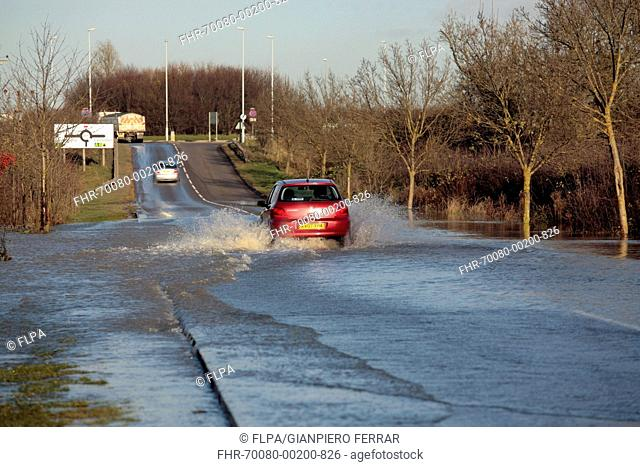Car driving through flooded rural road, Soar Valley, Leicestershire, England, November 2012
