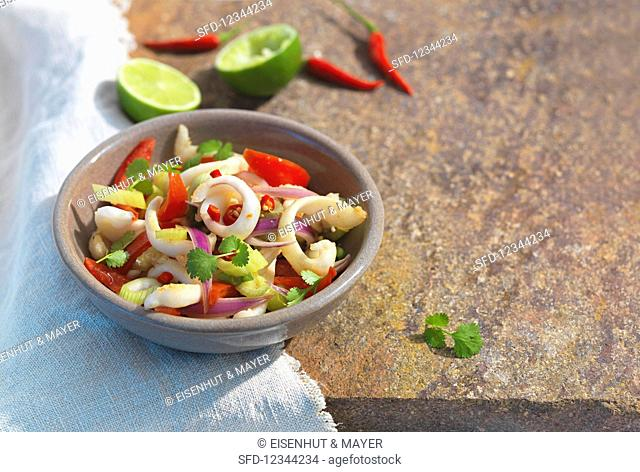 A squid salad with tomatoes, chilli, leeks and coriander