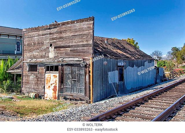 Abandoned building next to railroad tracks in Alviso, California