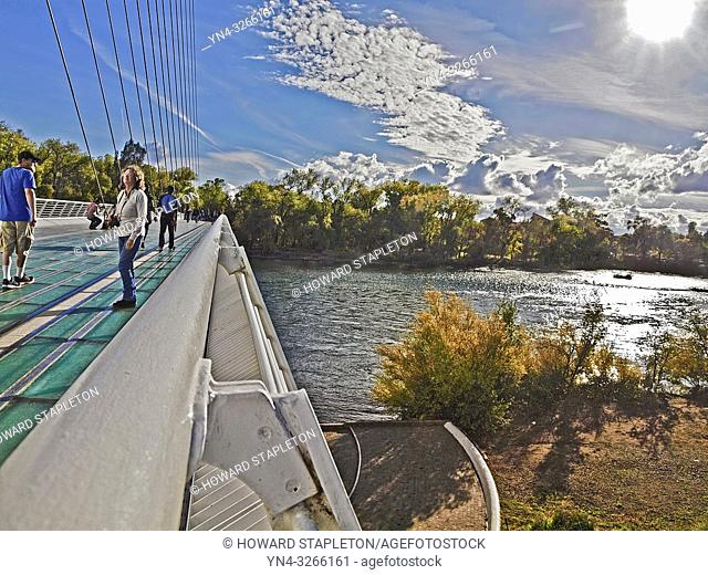 Sundial Bridge in Redding, California. This 710 foot span crosses the Sacramento River, and forms a working sundial. The glass decked bridge is used only for...