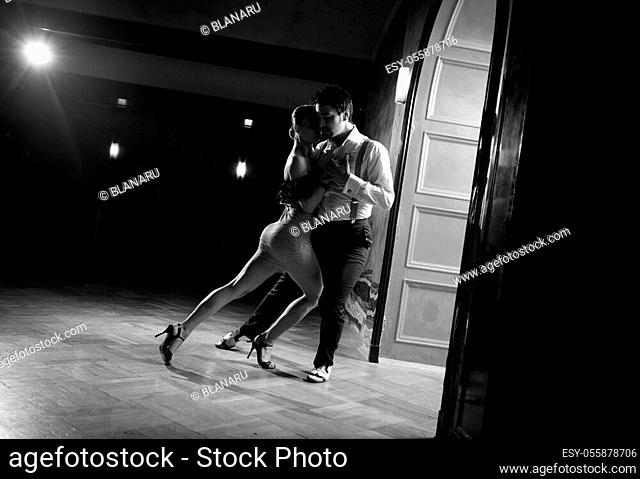 Beautiful dancers performing an argentinian tango dance. Black and white image for more effect