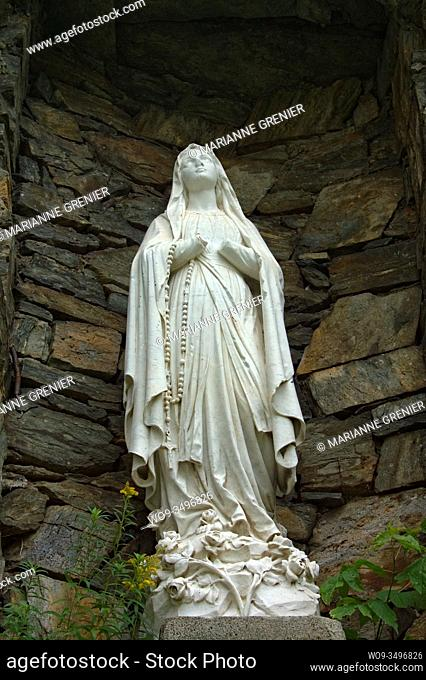 A picture of the Virgin Mary's statue taken in Immaculee-Conception church bottom view in color, Sherbrooke, Quebec, Canada