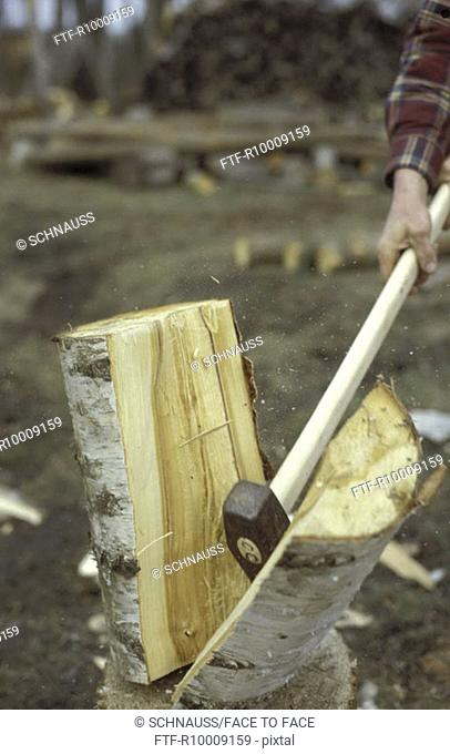 Axe in a block of wood