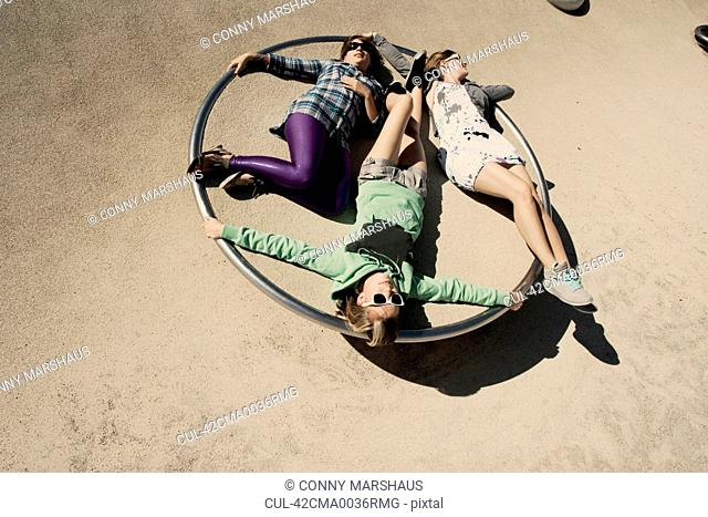 Women relaxing on playground