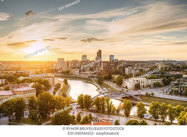 Vilnius, Lithuania. Sunset Sunrise Dawn Over Cityscape In Evening Summer. Beautiful View Of Modern Office Buildings Skyscrapers In Business District New City...