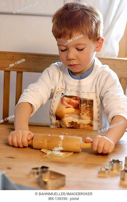 Boy baking cookies for christmas