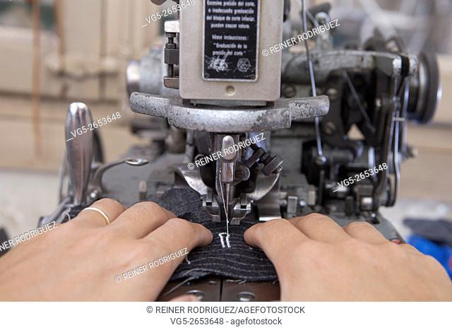 At a tailor in Barcelona, Spain. Production process of suit tailoring. Sewing of parts of a tailored jacket