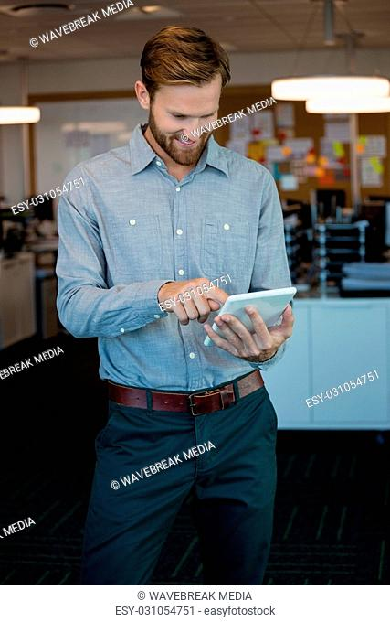 Male executive using digital tablet in office