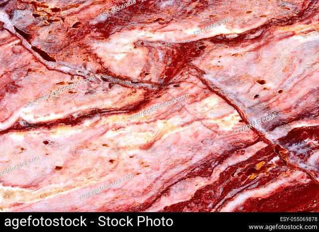 natural pattern of onyx red color polished slice mineral. Super high resolution. ONYX Onice Rosso Extra. Background