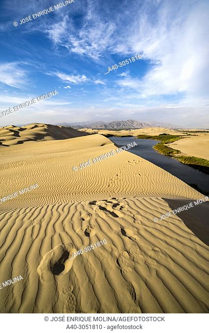 Desert of Ica in Peru, sand dunes and lagoon, South America
