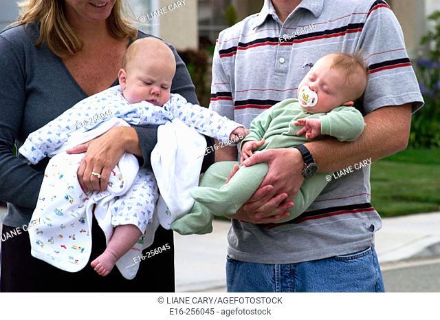 holding infants