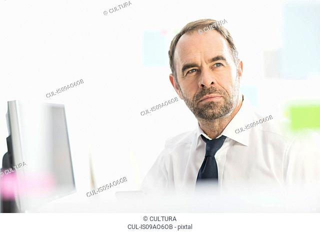 Businessman contemplating ideas in office