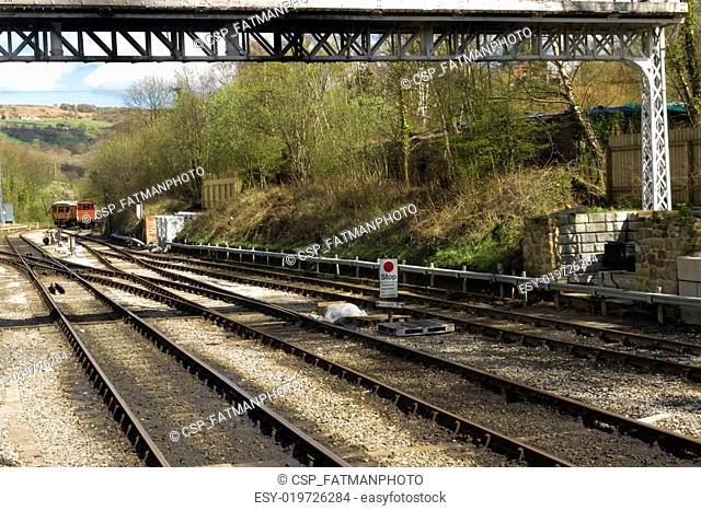Iron railway tracks converging on the North Yorkshire Moors Rail