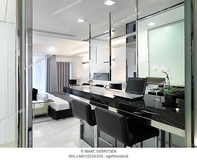 Black marble desk in modern home