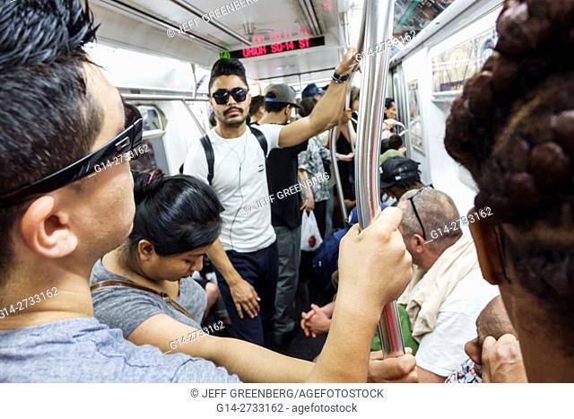 New York, New York City, NYC, Manhattan, subway, MTA, public transportation, rapid transit, train, Black, Hispanic, man, woman, standing, riding, passengers
