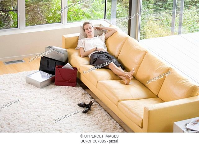Woman laying on sofa