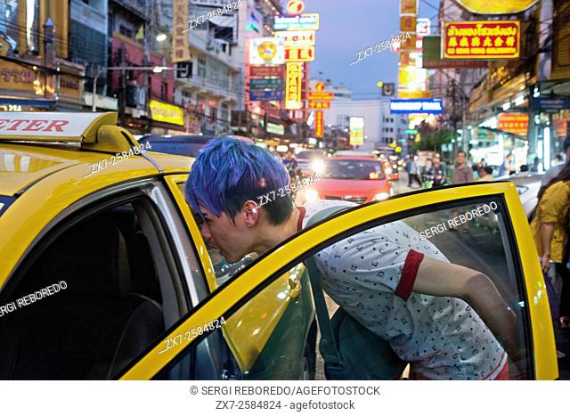 Taxi in the street. View down Thanon Yaowarat road at night in central Chinatown district of Bangkok Thailand. Yaowarat and Phahurat is Bangkok's multicultural...