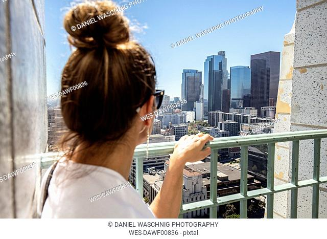 USA, California, Los Angeles, woman looking at the city from observation point