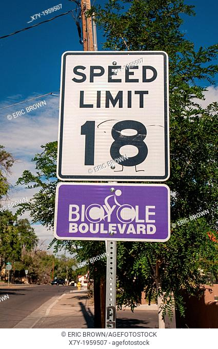 "Special speed limits are enforced in """"Bicycle Boulevards"""" where cars and bicycles have a speed limit of 18 miles per hour"
