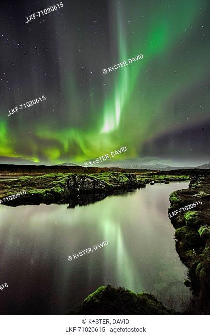 Reflection of northern lights aurora borealis in Thingvallavatn lake, National Park Thingvellir, UNESCO world heritage, Golden Circle, Southern Iceland, Iceland