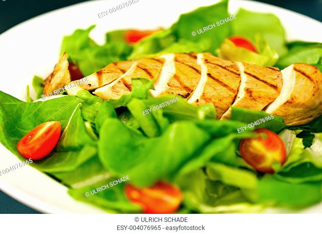 Sliced chicken breast as salad ingredient