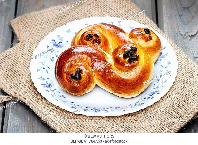 Traditional swedish saffron buns on hessian