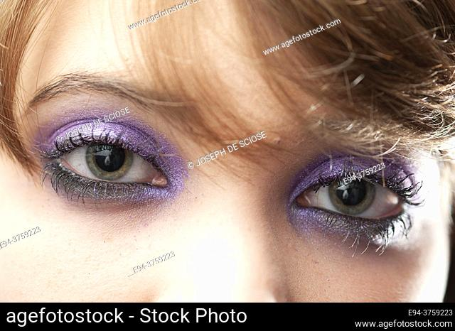 Close-up of eyes of and 18 year old brunette woman wearing
