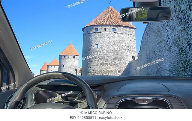 Looking through a car windshield with view of the iconic Hellemann tower and Tallinn's city wall, Estonia