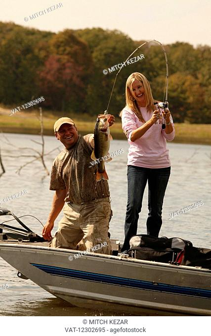 Man And Woman Bass Fishing From Boat