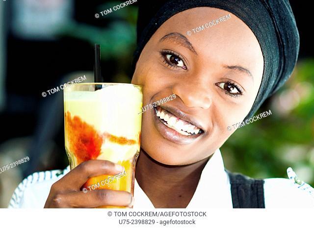 Young Kenyan woman in cafe, Nairobi CBD
