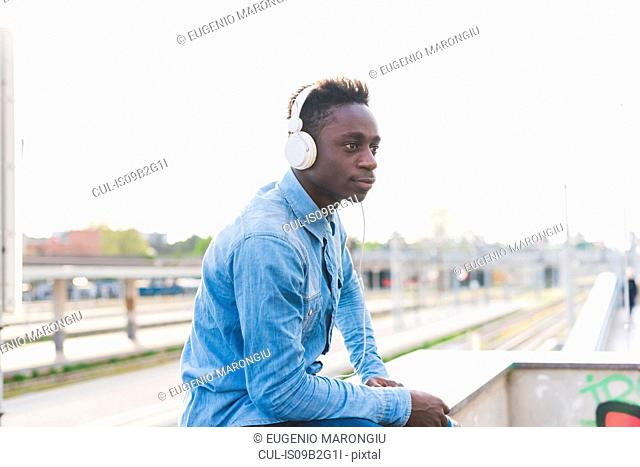 Portrait of man wearing headphones looking away, Milan, Italy