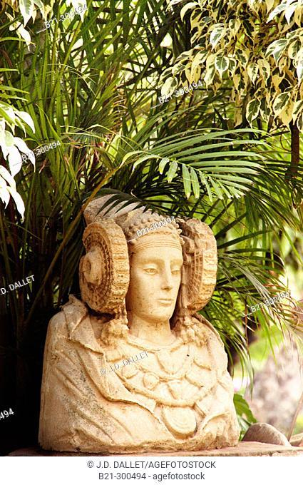 Dama de Elche ('Lady of Elche'), painted limestone bust example of 5th-century-BC Iberian art: replica at Huerto del Cura gardens. Elche