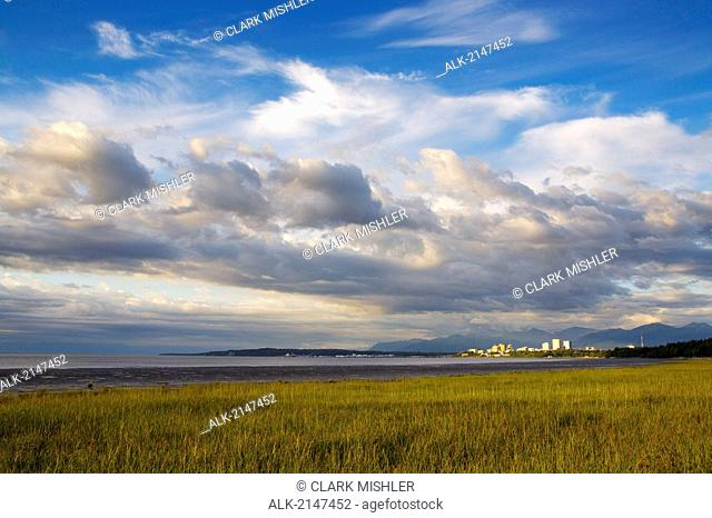 Downtown Anchorage Against Storm Clouds From Tony Knowles Coastal Trail Southcentral Alaska Summer