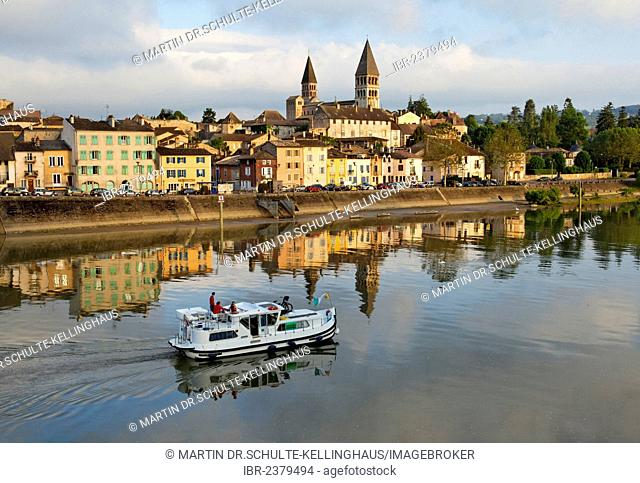 Abbey Church of St. Philibert and Saône river with houseboat, Tournus, Département Saône-et-Loire, France, Europe