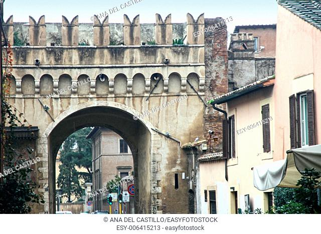 Old gate in Trastevere is a typical district of Rome, Italy