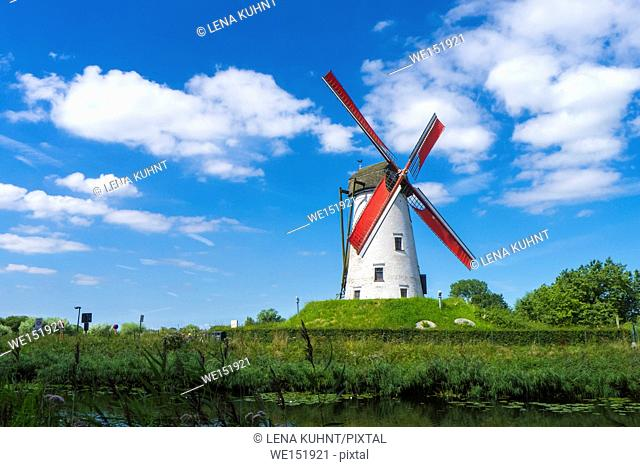Belgium, West Flanders (Vlaanderen), Damme. Hoeke Mill (Hoekemolen) windmill on the Damse Vaart canal