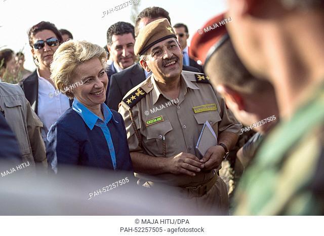 German Minister of Defence Ursula von der Leyen (CDU, 2-L) talks to Kurdish Peshmerga Officers at a barracks near Erbil, Iraq, 25 September 2014