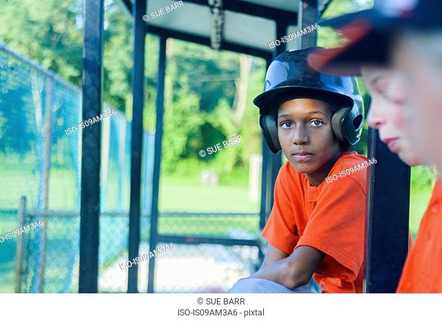 Young male baseball players waiting to play
