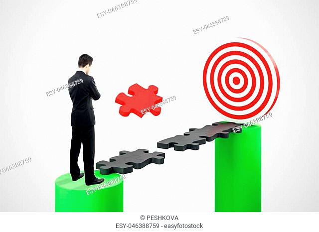 Abstract background with thoughtful businessman standing on puzzle gap with dartboard. Strategy and aiming concept. 3D Rendering
