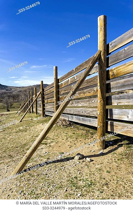 Wooden fence at Dehesa meadows. El Barraco. Avila. Spain. Europe