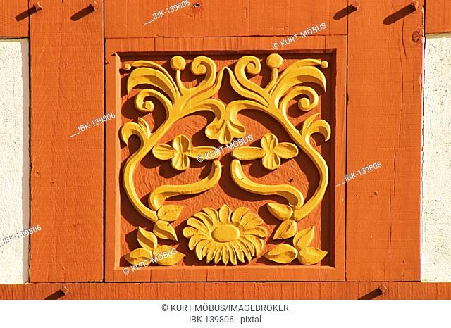 Carved work at a framework facade in the open-air museum Hessenpark, hesse, Germany