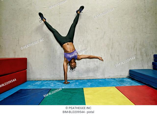 African American woman exercising in gym