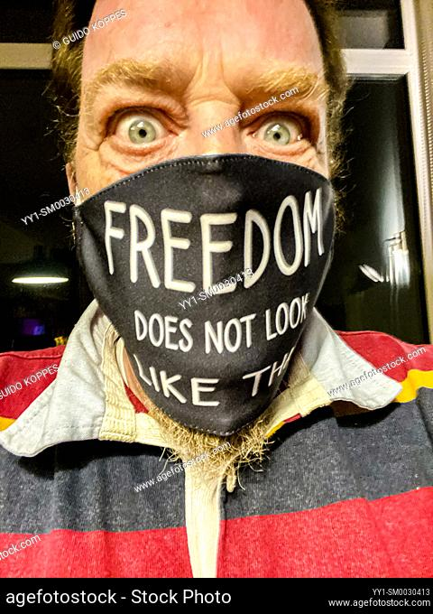 """Moergestel, Tilburg. Selfie wearing a Corona Facemask with the Phrase: """"""""Freedom does not look like this!"""""""""""