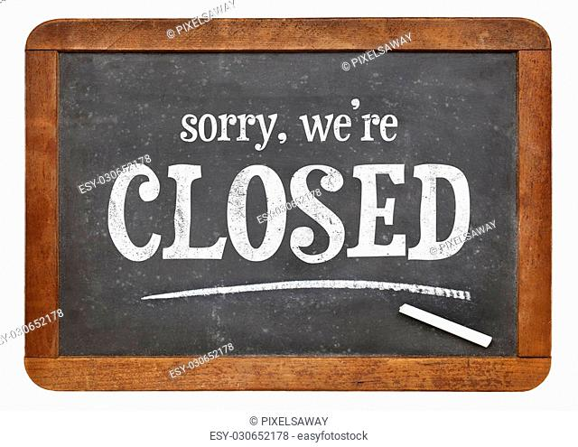 Sorry, we are closed - text on a vintage slate blackboard