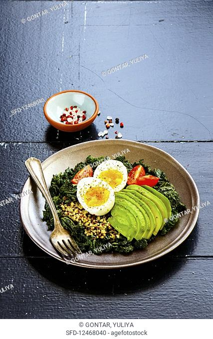 Qunioa salad with kale, avocado, egg and tomatoes