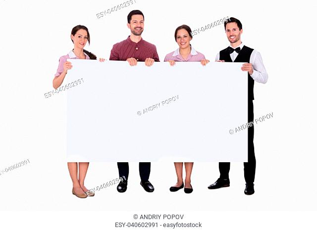 Portrait Of Smiling Staff Holding Blank White Billboard